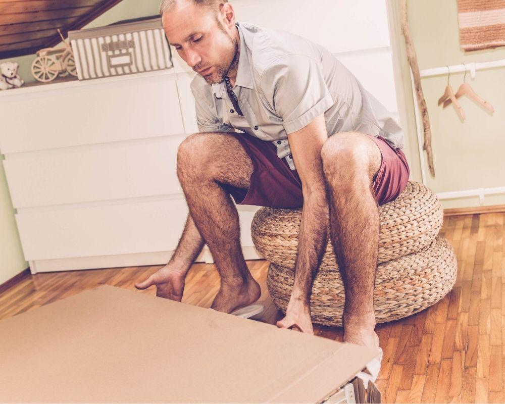 dad putting nursery furniture together
