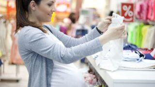 pregnant woman shopping for baby stuff