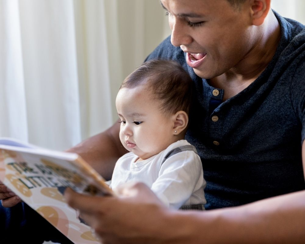 dad reading baby books