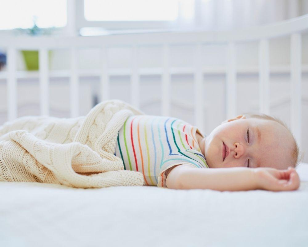 baby asleep in crib