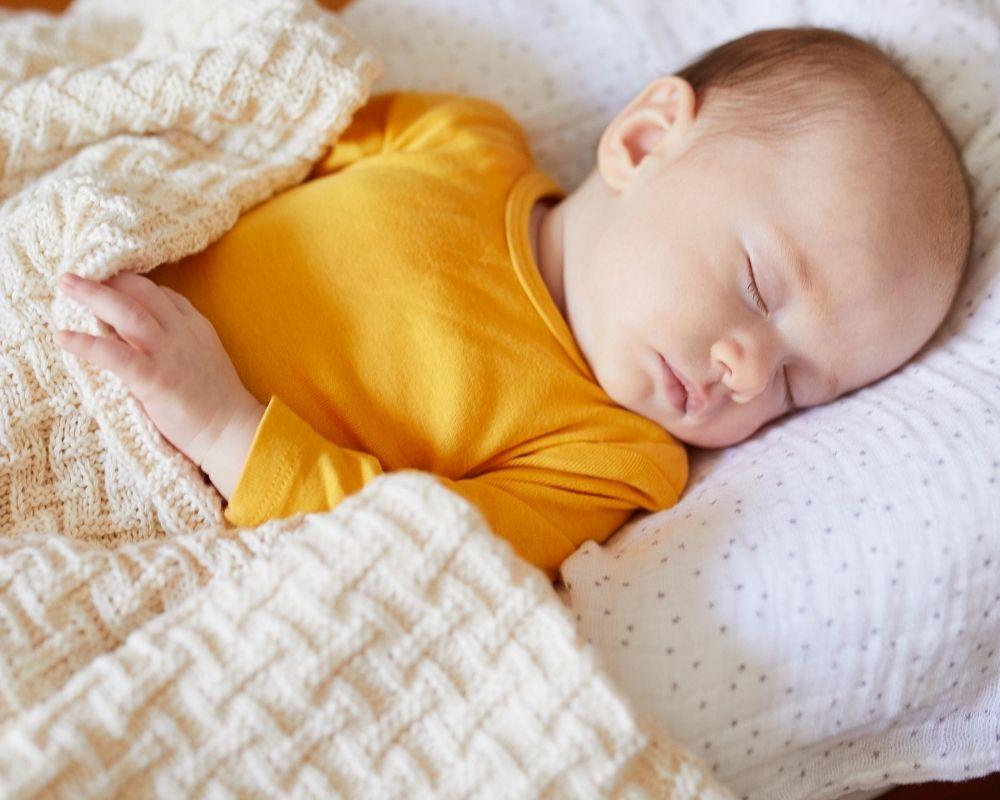 baby sleeping with blanket
